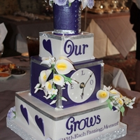 Our Love Grows With Each Passing Moment This wedding cake holds a special place in my heart because I made for my wedding. The clock worked too!