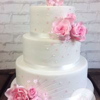 Sweet Roses Wedding Cake This wedding cake i made last weekend for a young couple who didn't know what kind of wedding cake they wanted. They loved roses and...