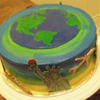 World Travel Cake White cake, covered in buttercream. With candy melt (Mercken) accents.