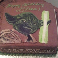 Yoda Birthday Cake Chocolate cake with chocolate icing, buttercream Yoda image.