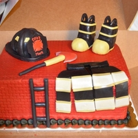 Fireman Cake   BC cake, fireman accessories are made out of rkt , fondant, & gumpaste.