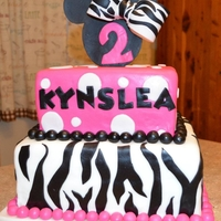 Minnie/zebra Cake   Fondant cake and minnie head was made out of gumpaste.