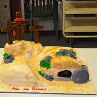 Empty Tomb Cake Pastor appreciation cake. Cake is fondant, crosses are gumpaste, rocks are fondant and dirt road is graham cracker crumbs.