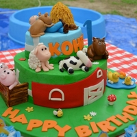 Barnyard Animal Cake  This was my son's first birthday cake and i worked on it for weeks!Cake is BC, used fondant for the barn, fence, and i made all the...