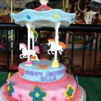 Carousel Cake *Cake for my 3 year old niece. Chocolate Cake with Chocolate ganache in middle. MMF all around.