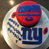 Ny Giants Birthday Cake Ny Giants Logo for my sons 7th Birthday. Red Velvet cake with fondant and fondant accessories.