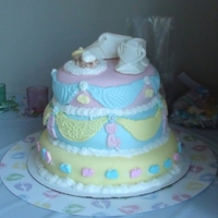 Babt Shower Cake Topper is gum paste babe and baby shoes. My first Baby Cake