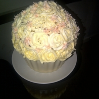 White Rose Large Cupcake   White chocolate shell with rose frosting (sorry i'm new at this :) !)