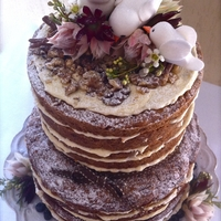 Rustic Wedding Cake My client asked for a carrot cake with no fondant and frills, she wanted a rustic cake that was good to eat and incorporated her husband,...