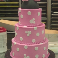 Minnie Mouse Three tier half chocolate, half yellow.. very, very pink cake. Polka dots are fondant. Dome is styrofoam covered in black Satin Ice and...