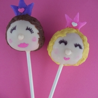 Princess Cake Pops A blonde and brunette pretty princess cake pop with pink and purple fondant crowns.
