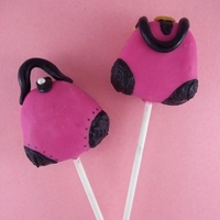 High Fashion Pocketbook Cake Pops Pink and Black Pocketbook Cake Pops are right on fashion-trend. Straps are made with black fondant.