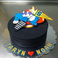 Grooms Cake Duck Down Records/Vikings/Syracuse themed grooms cake. Black fondant records, gumpaste logo/text.