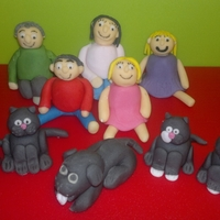 Sugarpaste Family This was my first attempt at making figures - it was a surprise for my cousin on her birthday. The figures are her family and pets! They...