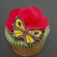 Painted Butterfly On Flower Cupcake with a hand painted butterfly on a hand made flower.