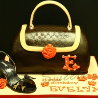 Purse And Shoe Cake  This is a big purse ... 6 layers of chocolate cake :) The shoe is a replica of the celebrant's favorite shoe. I used confectioner&#039...