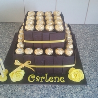 Ferrero Rocher Chocolate Cake Made for my cousins girlfriend who loves chocolate and the colour yellow. Cake was chocolate mudcake cake with choc buttercream covered in...