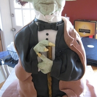 Yoda In A Tux This cake I did was for a Groom's cake. The bride-to-be asked me if I could create Yoda in a tuxedo with his ragged cape.