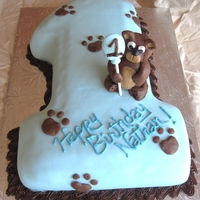 "First Birthday Bear Cake First Birthday ""1"" Cake with modeling chocolate paw prints and bear made out of modeling chocolate"