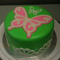 Butterflies On The Green Practice cake. Used to practice covering a cake with fondant and using my cricut cake.