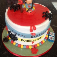 Horrid Henry triple layered chocolate cake decorated to immitate a paint can with models of horrid henry and friends
