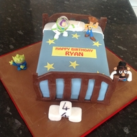 Toy Story Bed Cake sponge cake made to imitate toy story bed and charactors