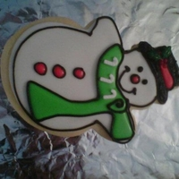 Snowman Cookies Sugar cookie decorated with swiss buttercream. Wilton Holly candy accent.