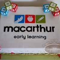 Early Learning Centre Corporate Cake Another very heavy cake! 17inches x 13inches x 5.5inches tall. Dark Chocolate Mud with Dark Chocolate Ganache. The blocks are fondant...