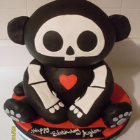 Skelanimal Monkey Cake Strawberry and vanilla cake with vanilla buttercream covered in fondant. Rice crispy treat arms, legs and ears. This is one of my favorites...