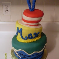 Dr. Suess Topsy Turvy Chocolate, vanilla and strawberry cake with vanilla buttercream covered in fondant.
