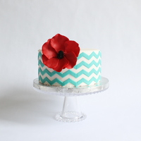 Teal Chevron Cake   Fondant chevron design with flower made out of modeling chocolate