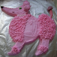 Pink Poodle Covered in buttercream with candy eyes, mouth and collar. A cookie for the ear.