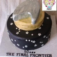 Live Long And Prosper! 50th birthday cake for a sci-fi fan! Classic white cake with almond buttercream filling (both tiers). Silver and gold handpainted with...
