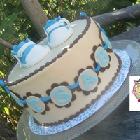 It's A Boy Shower Cake!  8 inch Classic Vanilla Cake with Vanilla Buttercream (tinted blue of course!) filling sprinkled with semi-sweet chocolate bits. Frosted in...