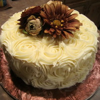 Rosette Cake White chocolate ganache rosettes. (I cheated with the flowers though :) )