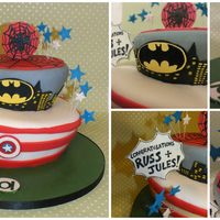 Wonky Cakes! Superhero wonky cake with hand-painted logos!