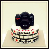 8 Inch Round Cake With Camera Topper Made Out Of Rkt 8 inch round cake with camera topper made out of rkt..