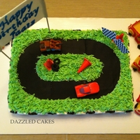 Racing Car Cake vanilla cake with butter cream icing. All decorations made with fondant