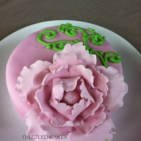 Cake With Peony Vanilla cake covered with fondant and decorated with peony flower and swirls