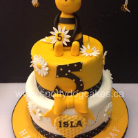 Two Tier Chocolate Cake With Rice Crispy Treat Bee And Fondant Embellishments Two tier chocolate cake with rice crispy treat bee and fondant embellishments.