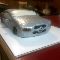 First Car Cake Disaster My first ever car cake. A bumpy, lopsided mess lol...now I have Mikes DVD so the next one will be better lol.