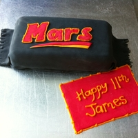 Mars Bar Birthday Cake Was asked to make a mars bar cake by my nephew for his birthday. I took it literally ;)Cake filling is Mars bar cake as well. It was well...