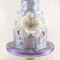 Klimt Inspired Wedding Cake This is a display wedding cake for 2014 featuring a Klimt inspired texturing on the cake and fantasy Parrot tulips and berries made from...