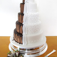 2 Sided Wedding Cake-Chocolate Vs. Classic This cake design has been replicted many times but I believe the original credit goes to: shockleys sweet shoppe. Here is my version, the...