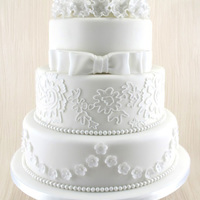 White Classic 4 Tier Wedding Cake Classic wedding cake with all edible decorations