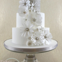 Wafer Paper Flowers Wedding Cake A new display cake for this season, featuring delicate shimmering wafer paper flowers in the style of fabric 3D flowers from bridal gowns