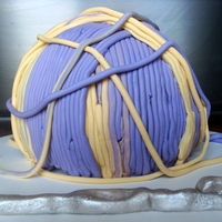 Yarn Ball Cake! A spur of the moment cake for my boyfriend's mother's birthday! For how quickly it got done, I'm happy with it! :)