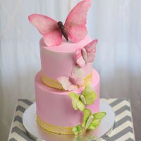 Clean And Simple Butterfly Shower Cake Hand Cut Gumpaste Butterflys With A Wafer Paper Border Clean and simple Butterfly shower cake. Hand cut, gumpaste butterfly's with a wafer paper border.