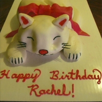 3D Kitty Cat Cake Chocolate cake shaped and covered with van buttercream and MMF. Hand painted details and MMF bow