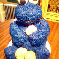 Cookie Monster  Cake is a yellow cake with a basic buttercream filling. Covered in Blue buttercream, eyes are made from fondant, arms are made from rice...